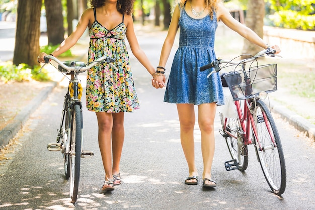 Two girls walking on the street holding hands