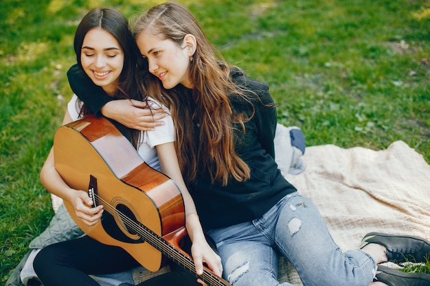 Two girls with a guitar
