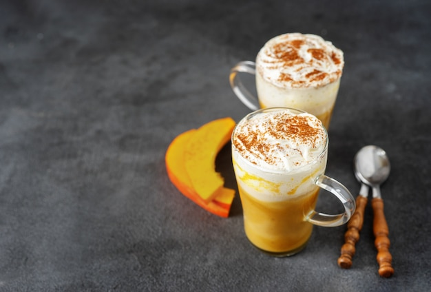 Two glass cups with spice pumpkin cappuccino