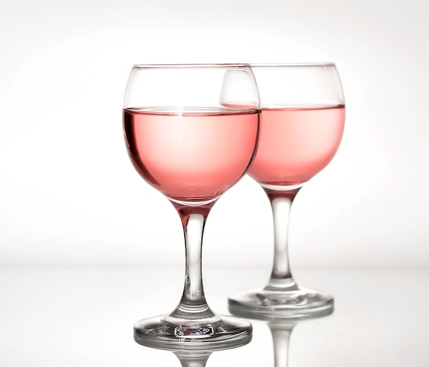Two glass glasses of rose wine.