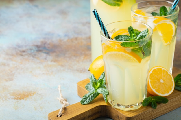 Two glass with lemonade or mojito cocktail.