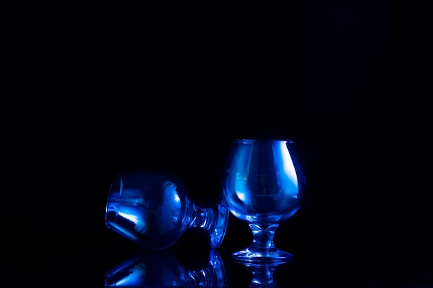 Two glasses for alcohol on black