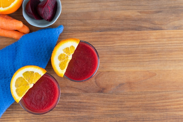Two glasses of beet juice on wooden bottom Premium Photo