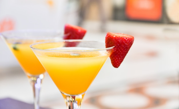 Two glasses of bellini cocktail with prosecco