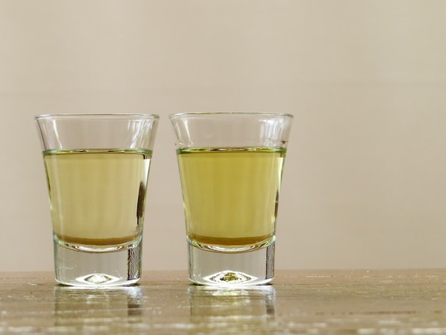 Two glasses of cachaca with space for text
