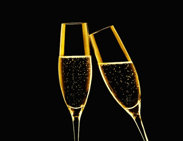 Two glasses of  champagne on a black background