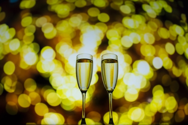 Two glasses of champagne on a bokeh background. close-up isolated background.