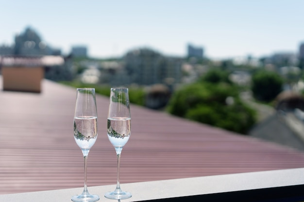 Two glasses of champagne on the roof
