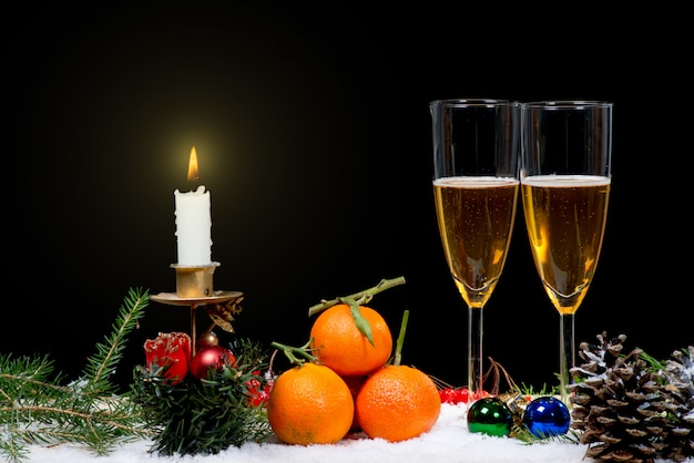 Two glasses of champagne with christmas decor