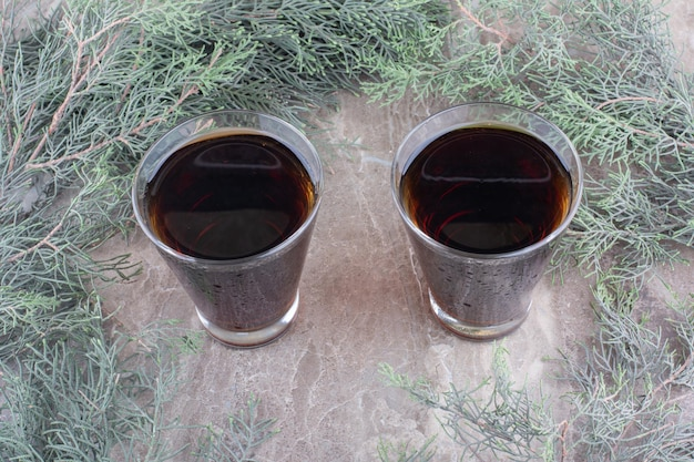 Two glasses of dark beer on marble table. high quality photo