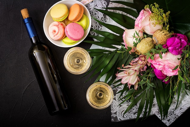 Two glasses of dry white wine and a macaroon