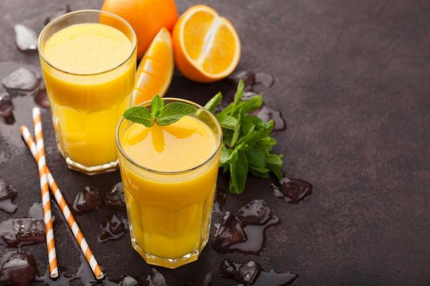 Two glasses of freshly squeezed orange juice.