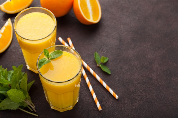 Two glasses of freshly squeezed orange juice.