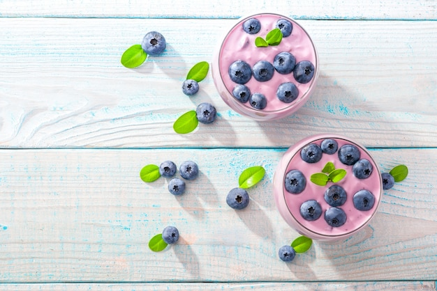 Two glasses of homemade  smoothie  on a wooden background