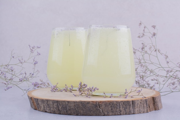 Two glasses of lemonade with herbs and spices