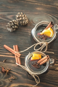 Two glasses of mulled wine on the wooden table