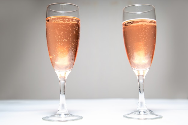 Two glasses of pink champagne on the table