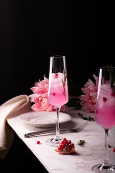 Two glasses of pink pomegranate sparkling lemonade for party