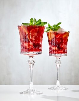 Two glasses of red sangria cocktail on restaurant table