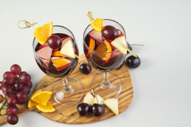 Two glasses of sangria with fruit decoration. traditional spanish drink. copy space. high angle.