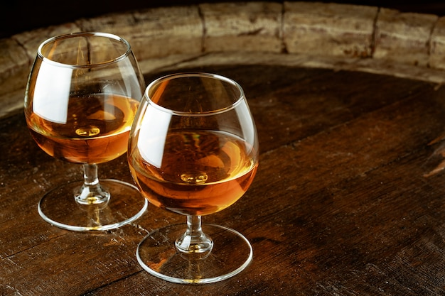 Two glasses of whiskey on a wooden table in the bar