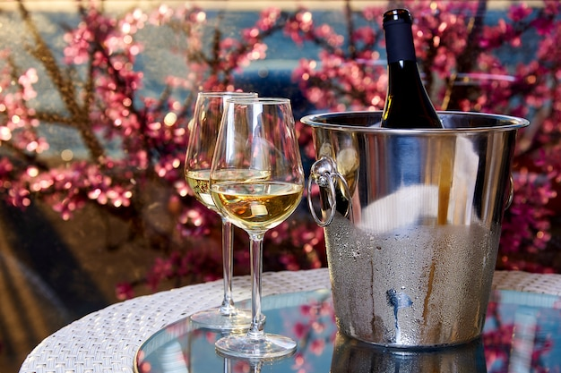Two glasses of white cold wine