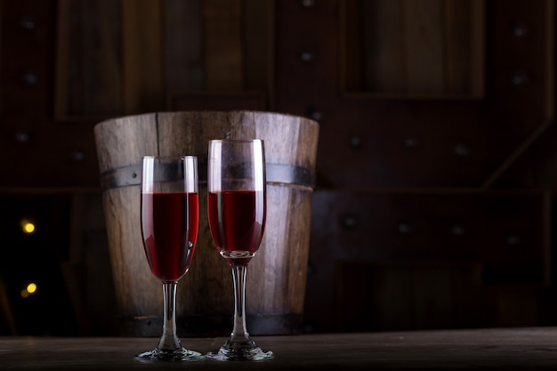 Two glasses of wine on wooden background