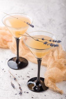 Two glasses with a cocktail martini