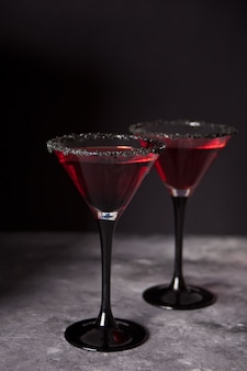 Two glasses with red cocktail for halloween party