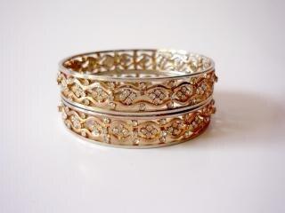 Two gold bangles, shiny