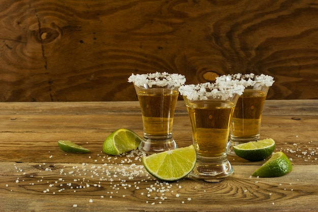 Two gold tequila shots, copy space