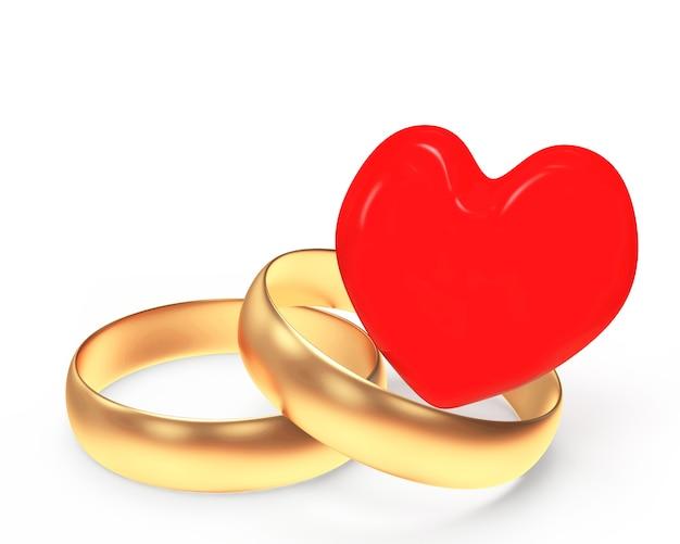 2つの金の結婚指輪と赤いハート