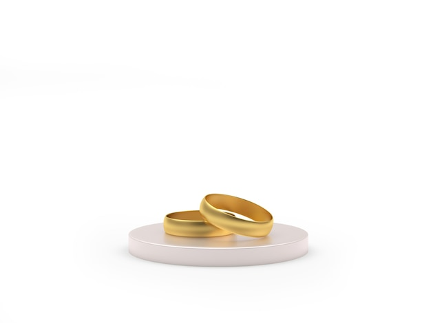 Two gold wedding rings on a round stand