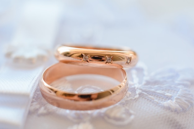Two gold wedding rings with diamonds for engagement