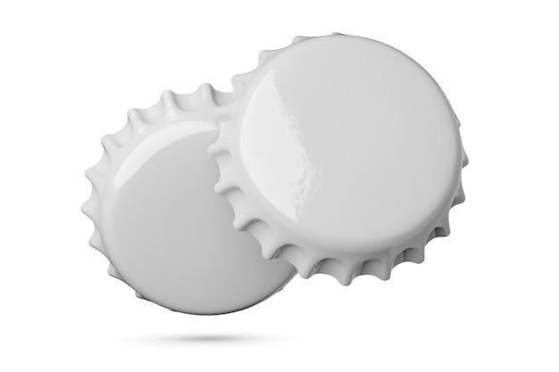 白で隔離の2つの灰色の金属ソーダまたはビールキャップ