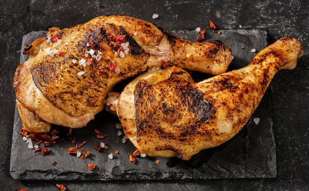 Two grilled chicken legs. view from above.