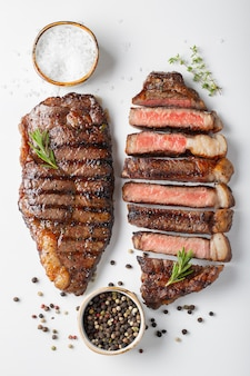 Two grilled marbled beef steaks striploin.