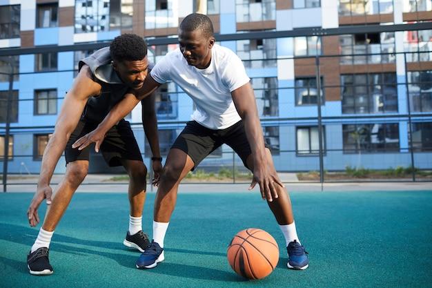 Two guys playing basketabll