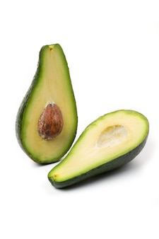 Two halves of avocado slices isolated on a white background