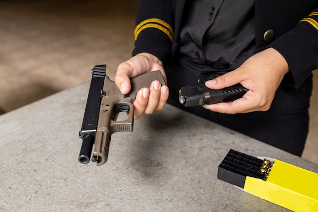 Two hand reloading law enforcement pistol in academy shooting range