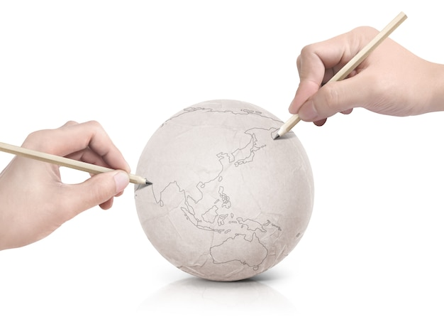 Two hand stroke drawing asia map on paper ball on white isolated