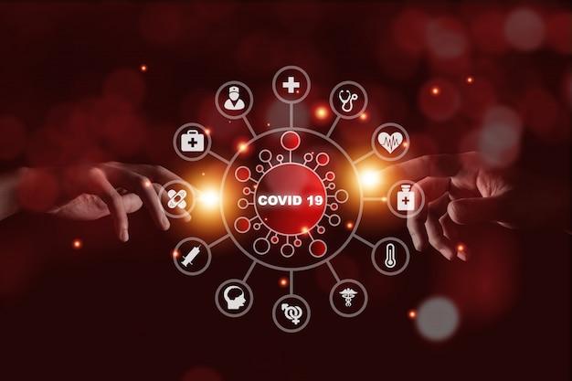 コロナウイルスと健康医療アイコンに触れる2つの手。