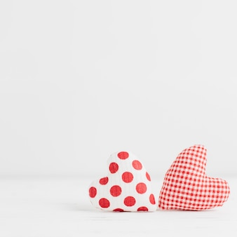 Two handmade heart shaped toys
