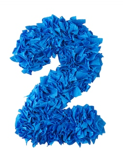 Two, handmade number 2 from blue scraps of paper isolated on white
