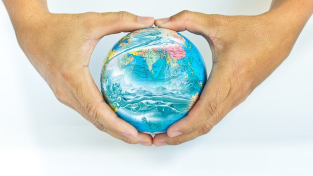Two hands holding the earth on white background