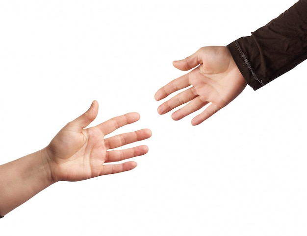 Two hands reaching out to each other isolated on a white backgro