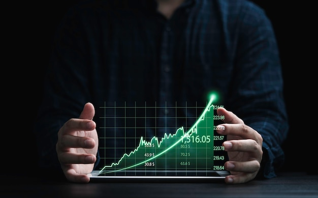 Two hands of trader protecting green graph chart with arrow for analysis stock market information , investment concept.