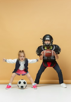 Two happy and beautyiful children show different sport.