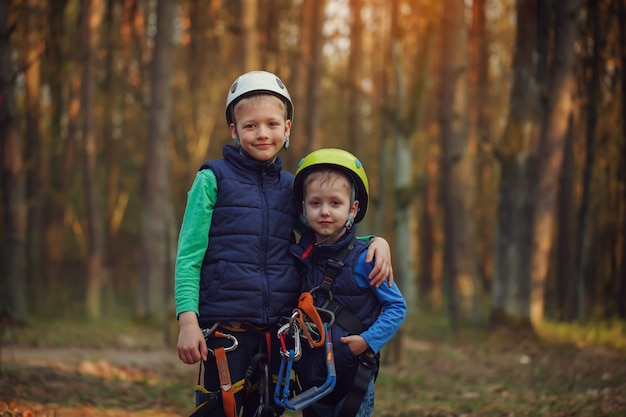 Two happy brave adorable  brothers, double portrait, looking at