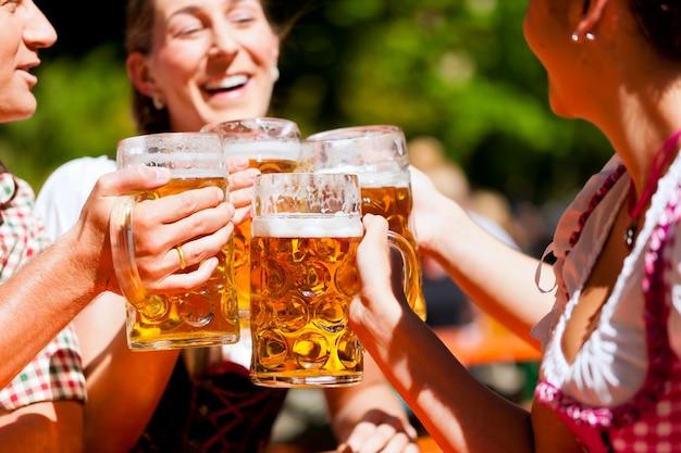 Two happy couple sitting in beer garden